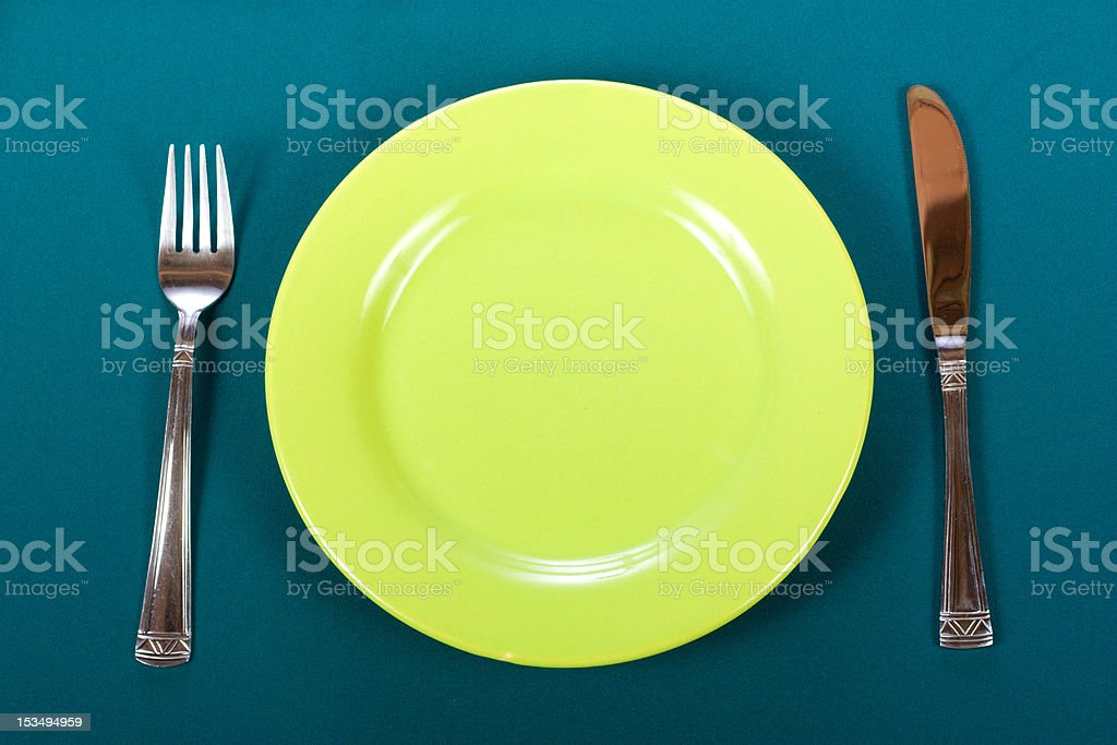 Knife, plate and fork royalty-free stock photo