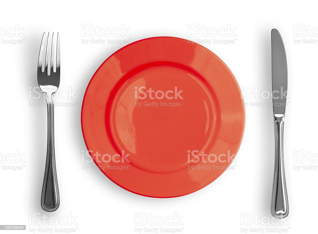 Knife, red plate and fork isolated stock photo