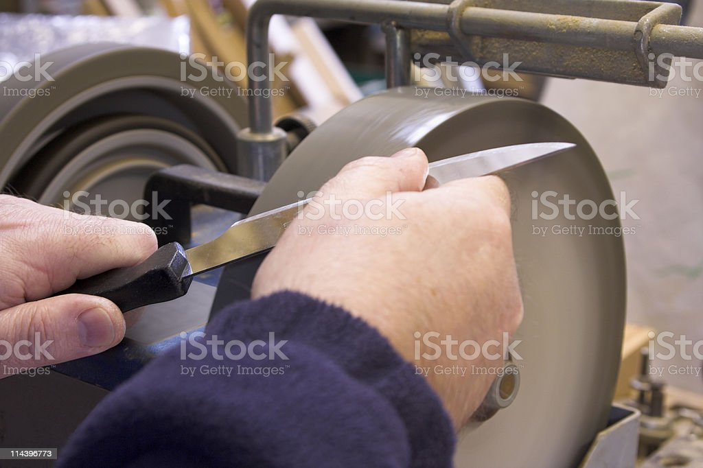 Knife Sharpening On Wet Grinder stock photo