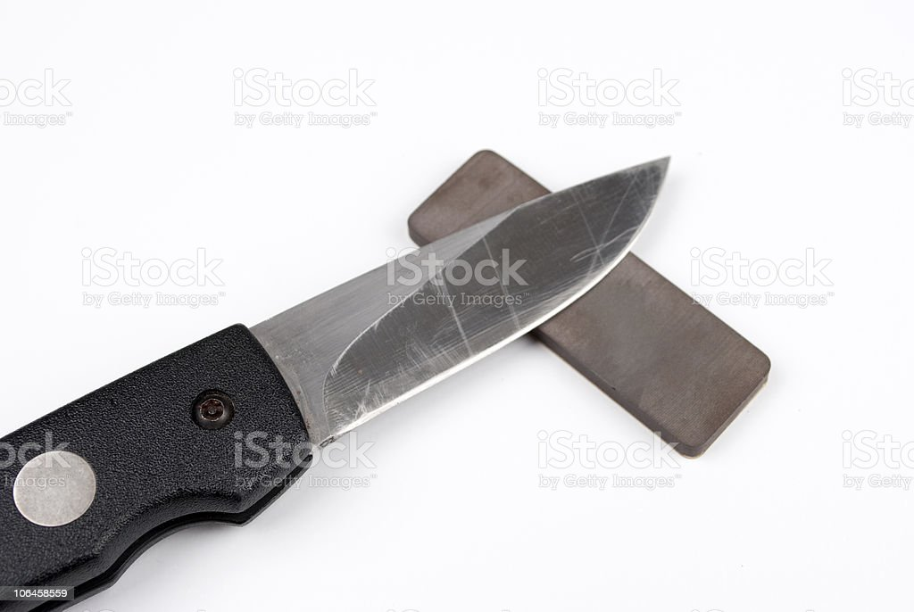 Knife sharpening stock photo