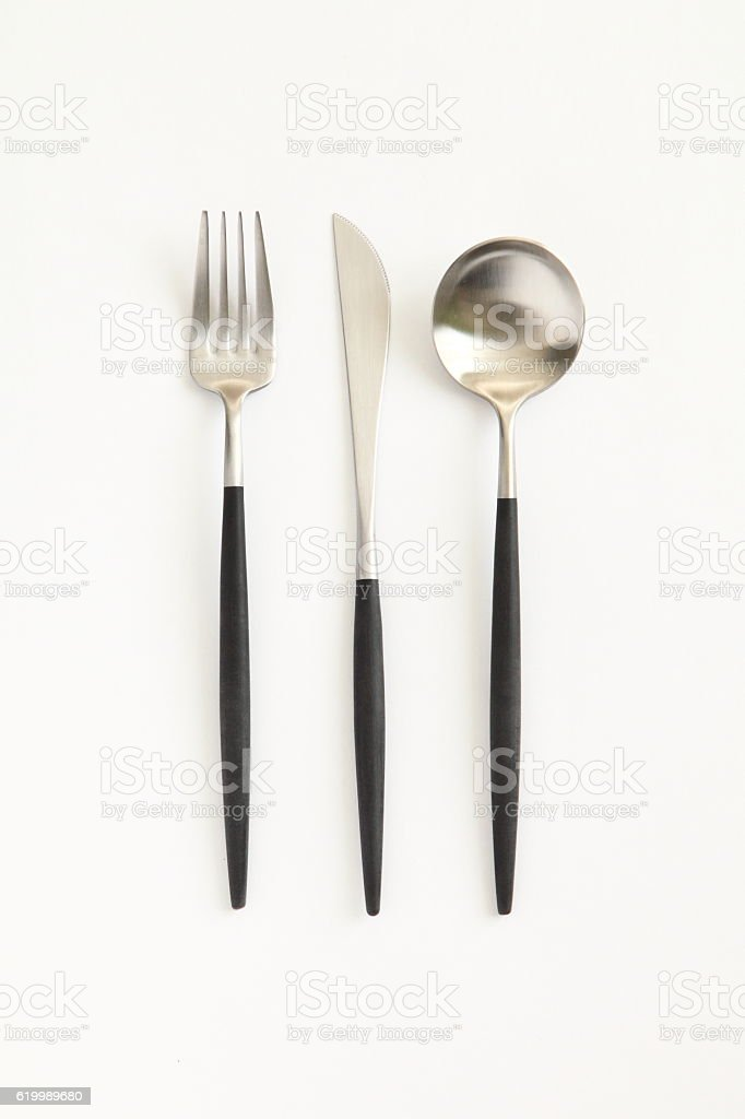 Knife, spoon and fork isolated on white background stock photo