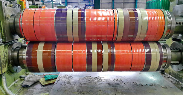 Knife stand and rubber ring for rolled steel coil slitting process in factory warehouse, coil center stock photo