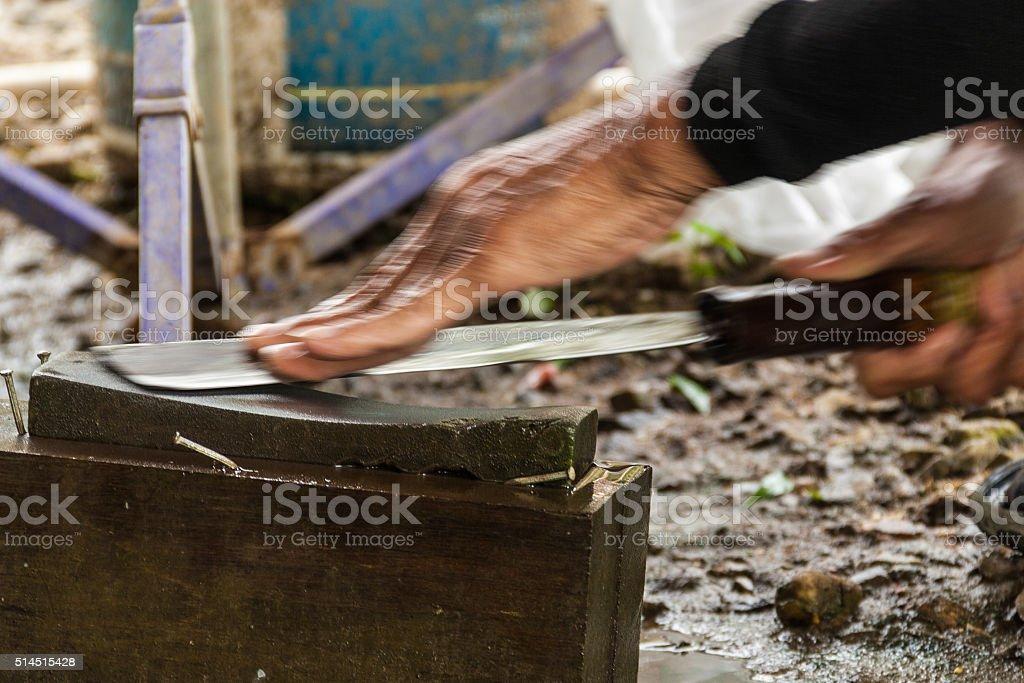 Knife whetting stock photo