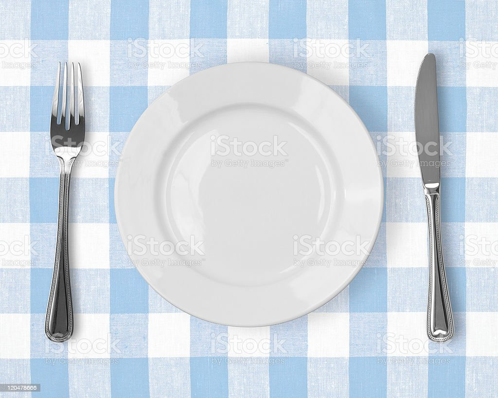 Knife, White Plate And Fork On Blue Checked Tablecloth Royalty Free Stock  Photo