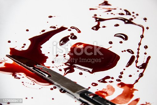 172646637 istock photo Knife with blood on the white background. Bloody background with knife - conceptual photo. 1226569419