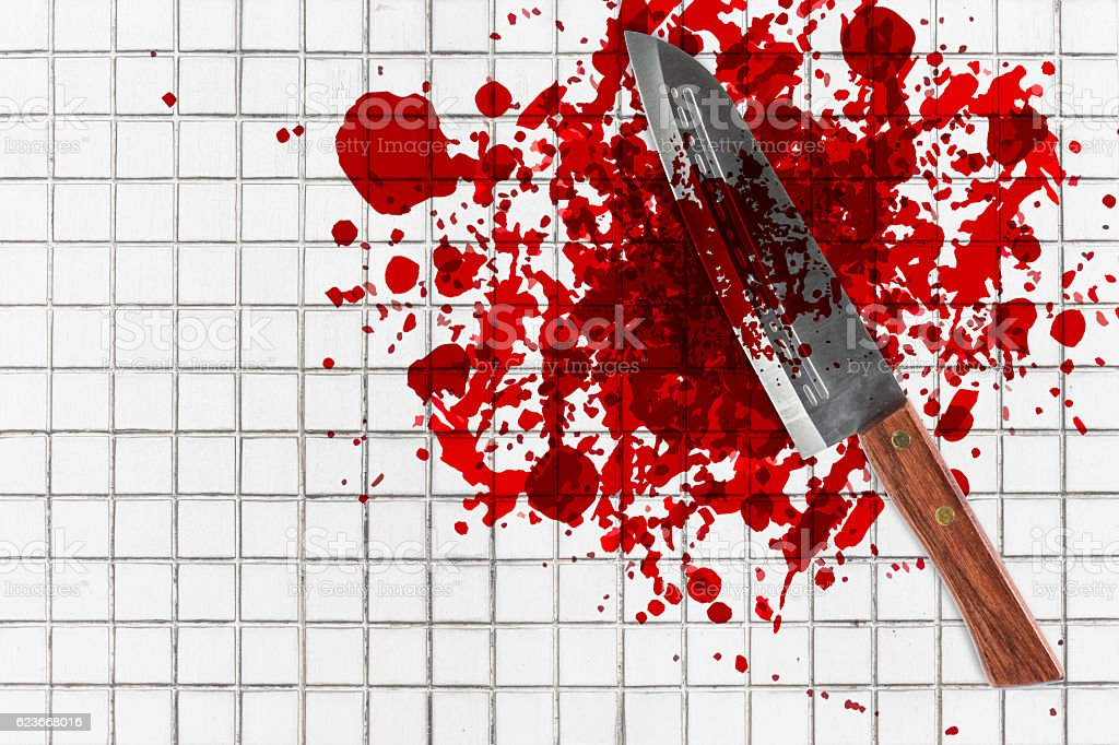 knife with grunge of blood on toilet mosaic floor stock photo