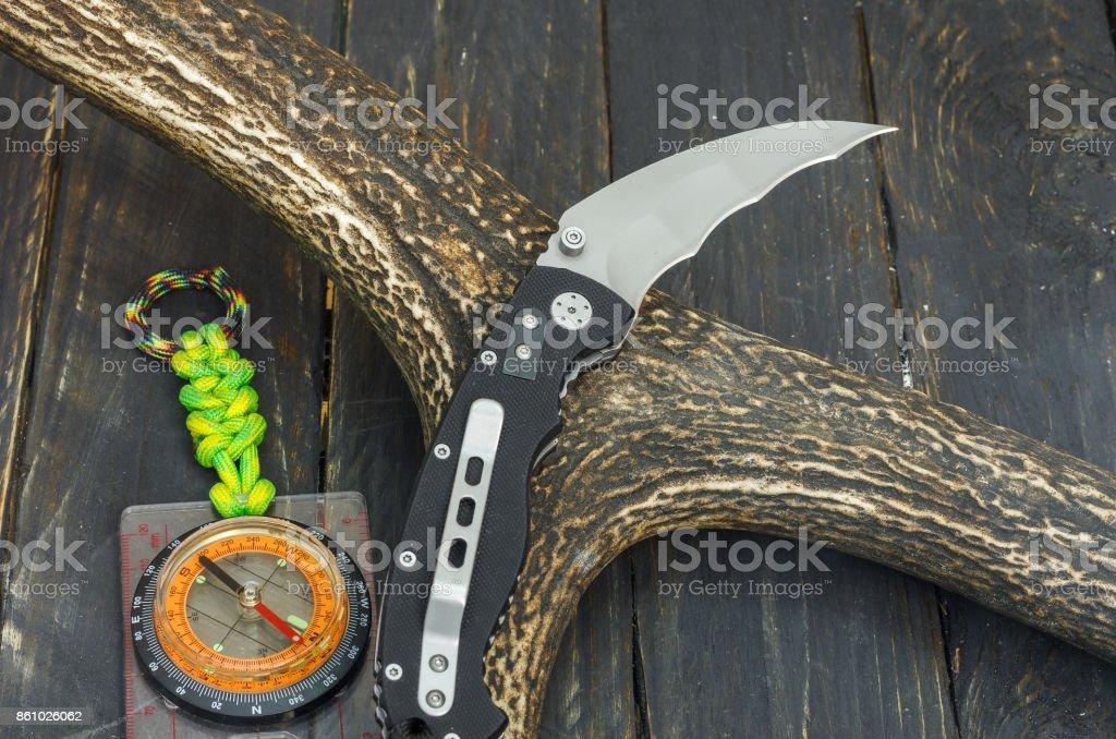 Knife with radial hawkbill blade. stock photo