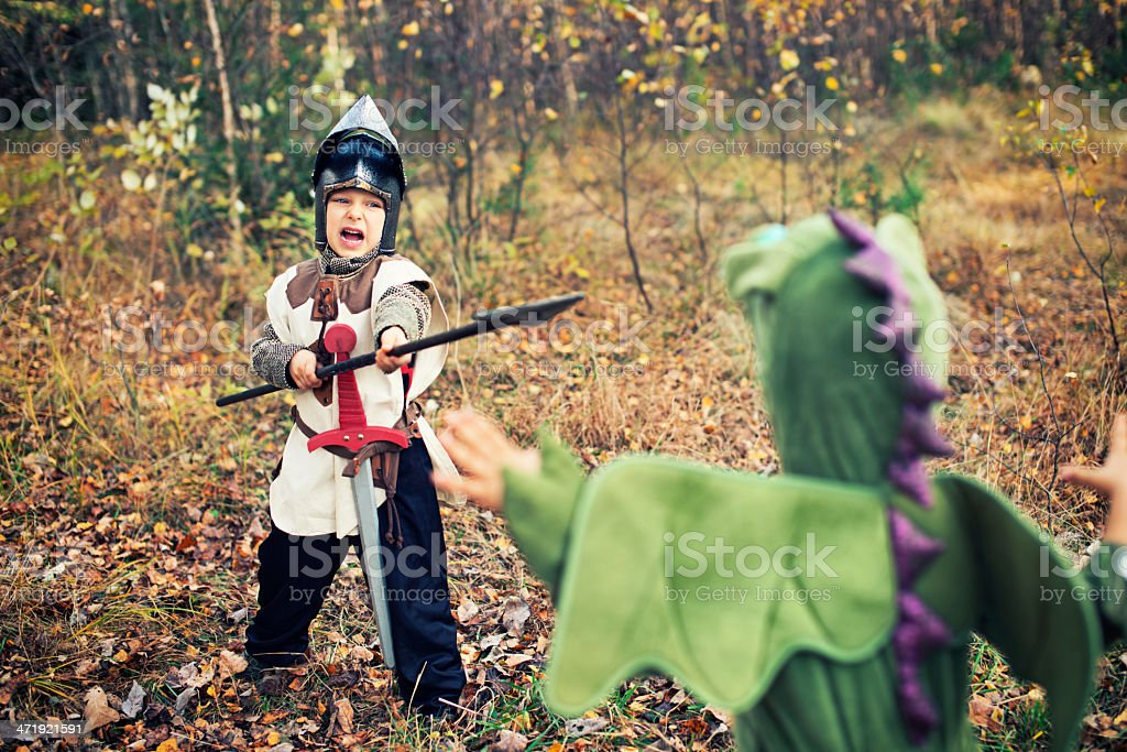 Knight fighting with green dragon. royalty-free stock photo