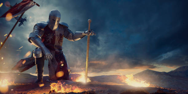 knight in amour kneeling with sword on hilltop near fire - fantasy stock photos and pictures