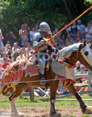 istock Knight in Armor on a Charging Horse, Jousting 92989971
