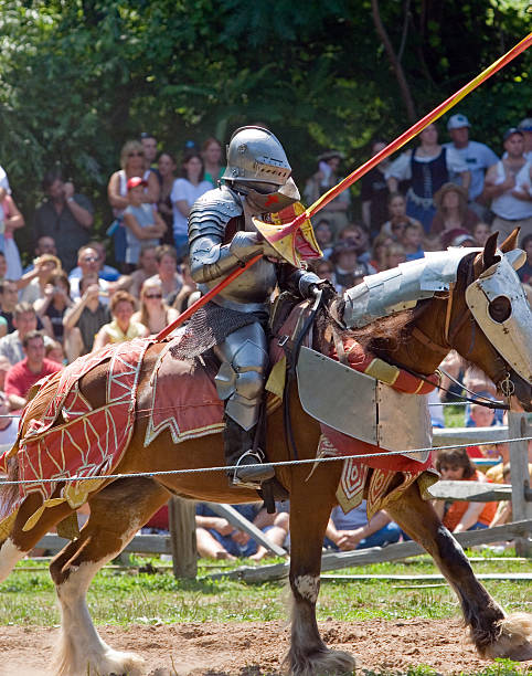 knight in armor on a charging horse, jousting - knight on horse stock photos and pictures