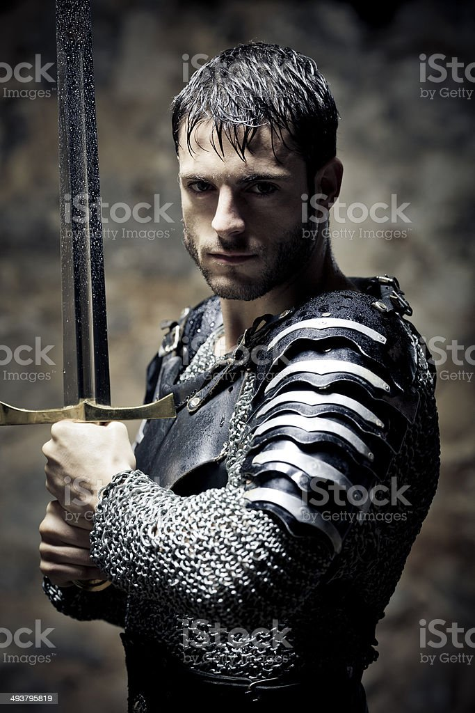 Knight in the darkness stock photo