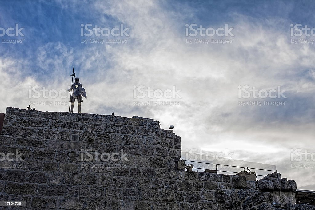 Knight on a wall stock photo