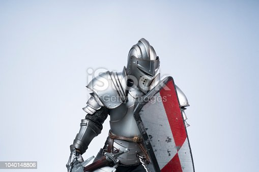 knight in silver armour with shield