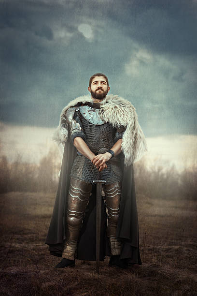 knight with sword in a field. - warrior person stock pictures, royalty-free photos & images