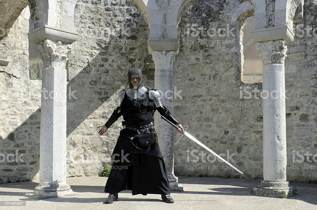 Knight with sword in the castle stock photo