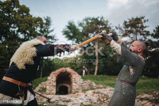 istock Knights fighting outdoors against each other 1164550604