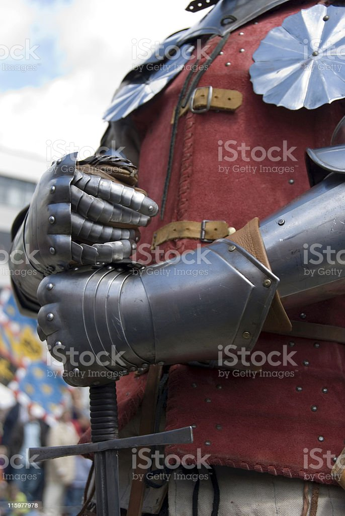 Knight's hands holding a sword royalty-free stock photo