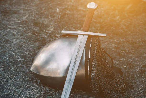 knight's helmet and shiny metal lying on the ground - the crusades stock photos and pictures