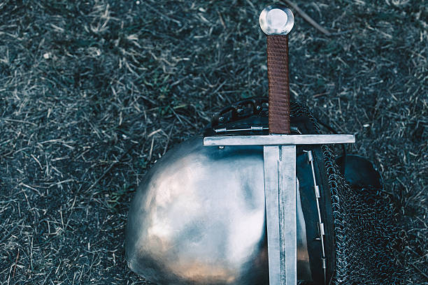 knight's helmet and sword. - the crusades stock photos and pictures