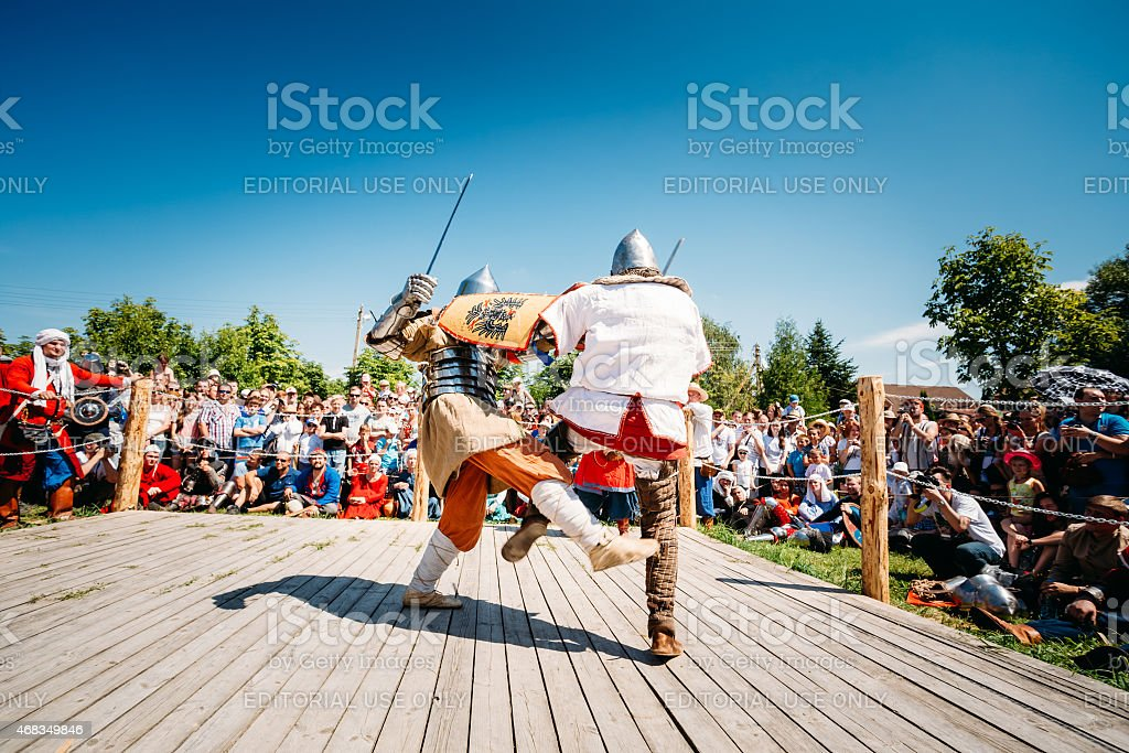 Knights In Fight With Sword. Restoration Of Knightly Battle royalty-free stock photo