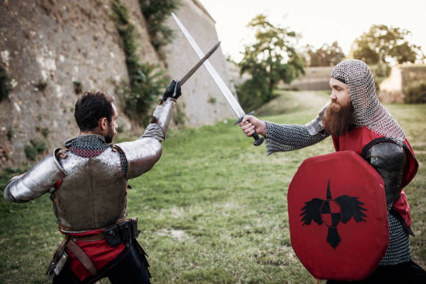 knights in sword fight in medieval times in europe - knights templar stock pictures, royalty-free photos & images