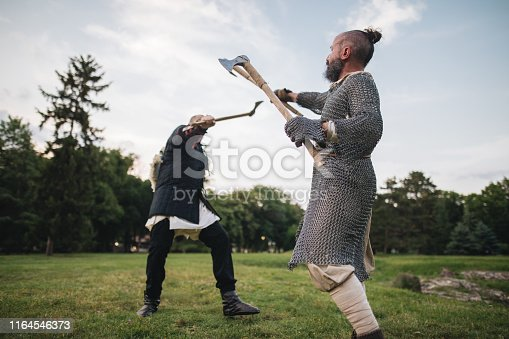 istock Knights with axes fighting a war 1164546373