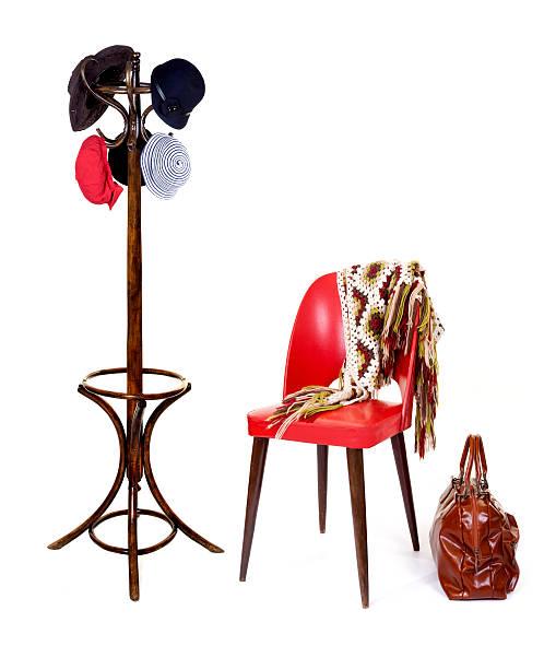 schal auf roten stuhl und mantel mit luggage rack - garderobenhaken stock-fotos und bilder