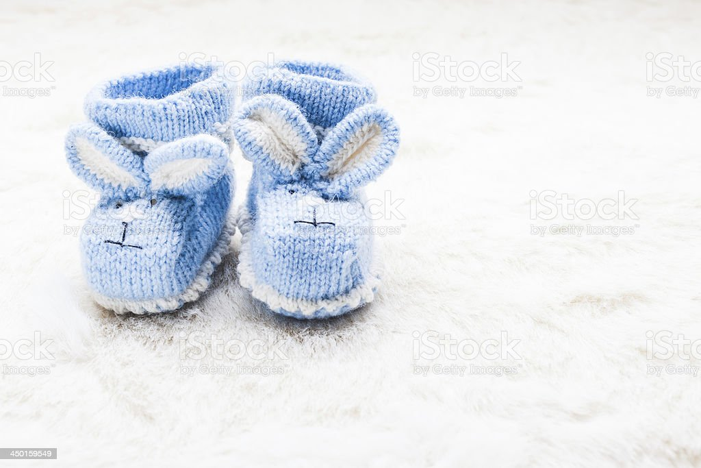 Knitted baby booties royalty-free stock photo