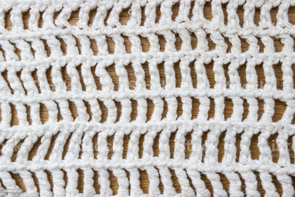 Knitted background. A sample of knitting from wool. Knitting Pattern. stock photo