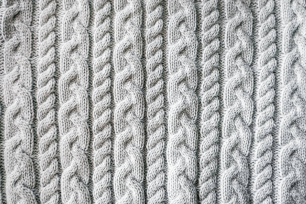 knitted background. knitted texture. a sample of knitting. knitting pattern. - maglione foto e immagini stock