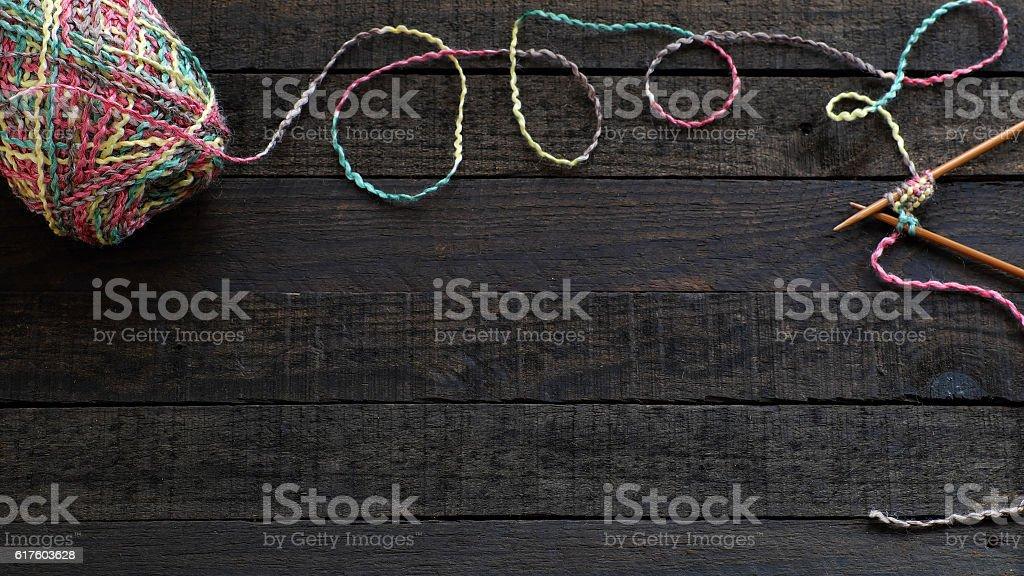Knitted background, knitting needle and yarn stock photo