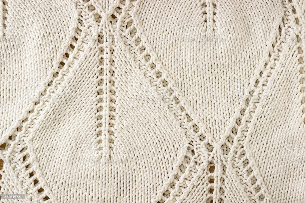 Knitted background. Knitting Pattern. Knitted texture. A sample of knitting. stock photo