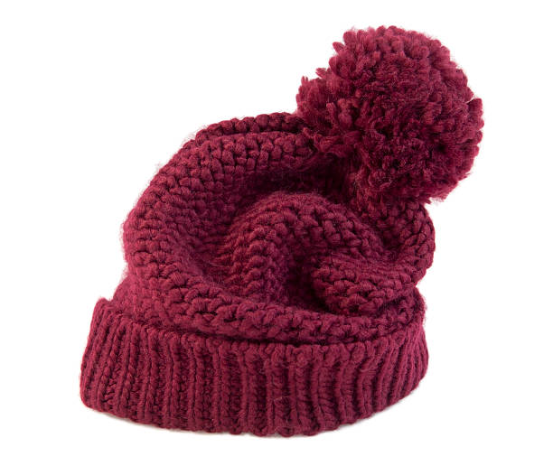 Knitted Beanie Knitted beanie, red wool cap. knit hat stock pictures, royalty-free photos & images