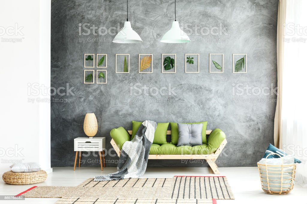 Knitted blanket on wooden sofa stock photo