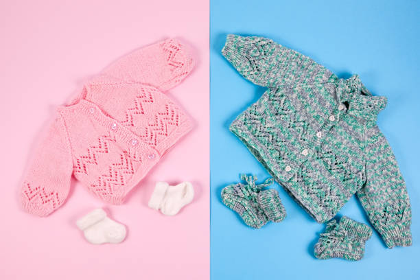 knitted boy and girl clothes - gender stereotypes stock photos and pictures