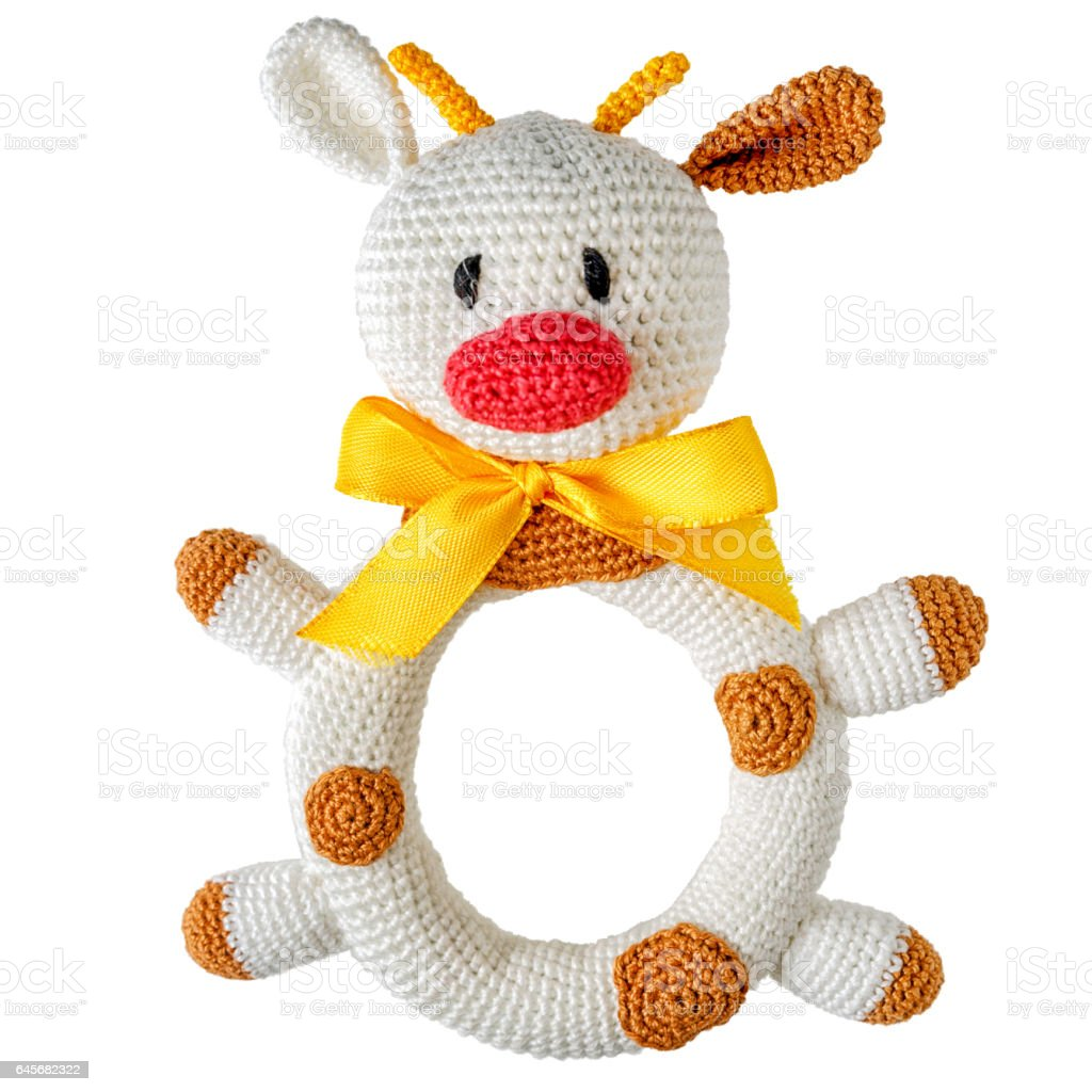 knitted children's toy cow isolated on white background stock photo