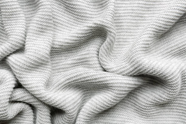 knitted fabric background - softness stock pictures, royalty-free photos & images