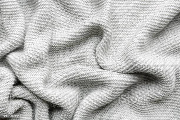 grey woolen knitted fabric as background