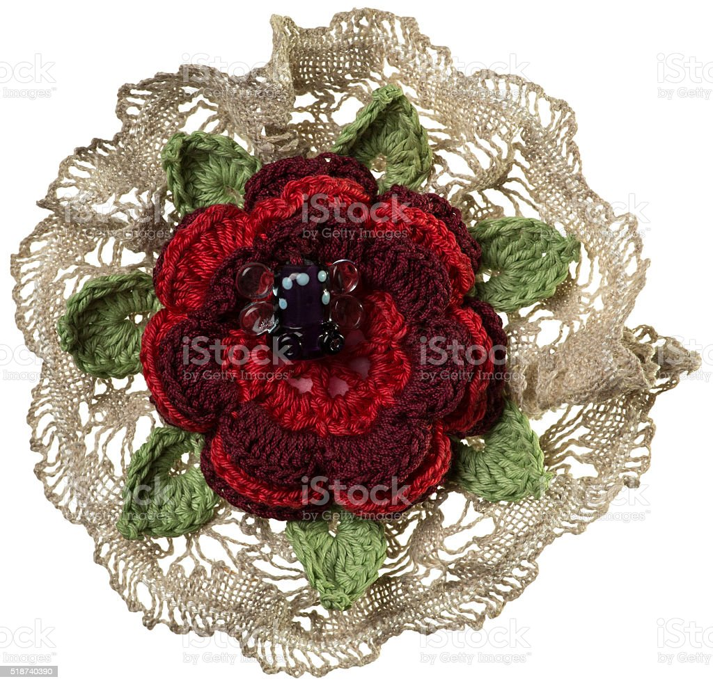 Knitted flower brooch stock photo