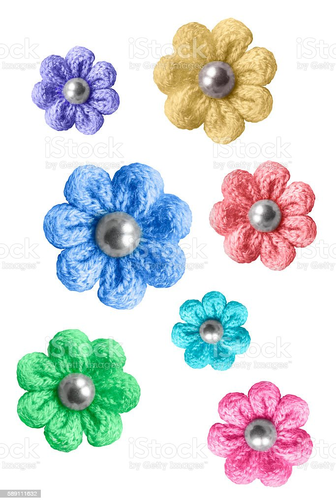 Knitted flowers isolated stock photo