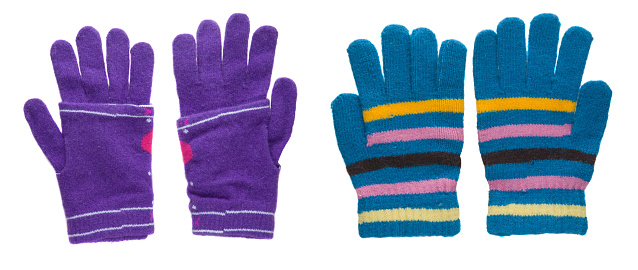 two pairs knitted in a strip gloves. gloves isolated on white background. gloves a top view