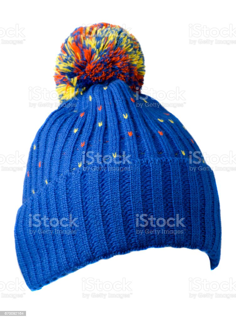 knitted hat isolated on white background .hat with pompon .     blue  hat - Photo