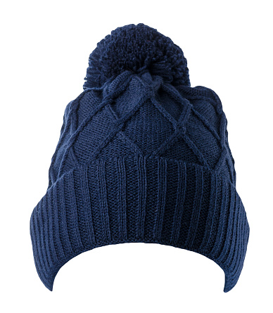 knitted dark blue hat isolated on white background.hat with pompon .