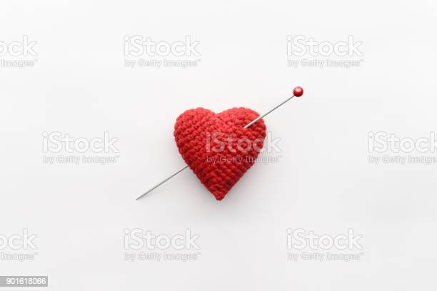 Knitted heart of red thread with inserted knitting needle on white picture id901618066?b=1&k=6&m=901618066&s=612x612&h=5gol b v0bqet5myrsdh8yn99rvkjekqwmgt2vzgm9w=