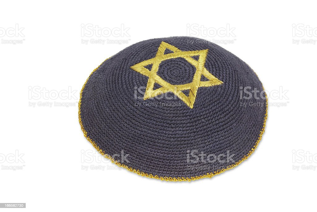 Knitted kippah with embroidered golden David star stock photo