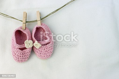 istock Knitted pink baby sandals 636236462