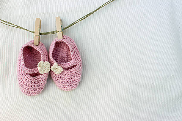 Knitted pink baby sandals Knitted baby sandals baby girls stock pictures, royalty-free photos & images