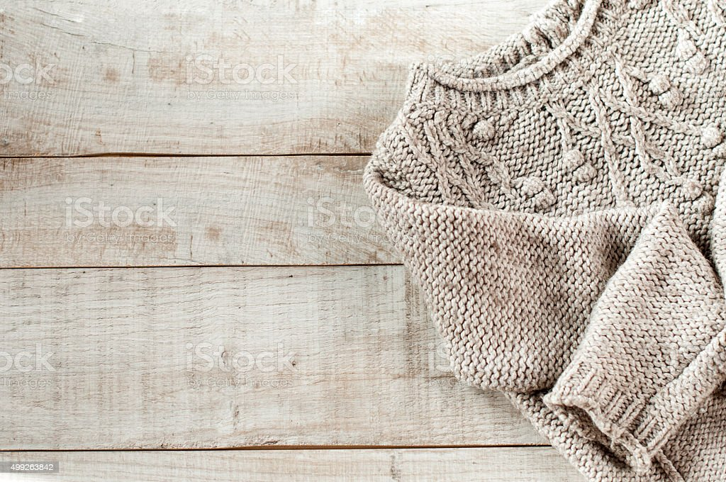 knitted pullover on wooden boards stock photo