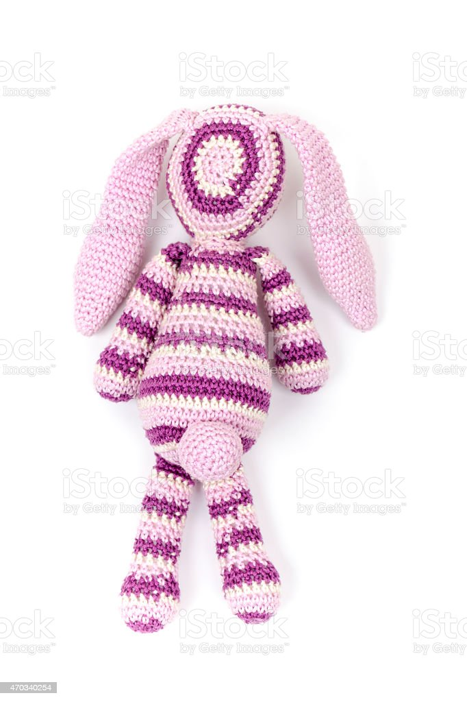 Knitted rabbit toy isolated on white with soft shadow stock photo